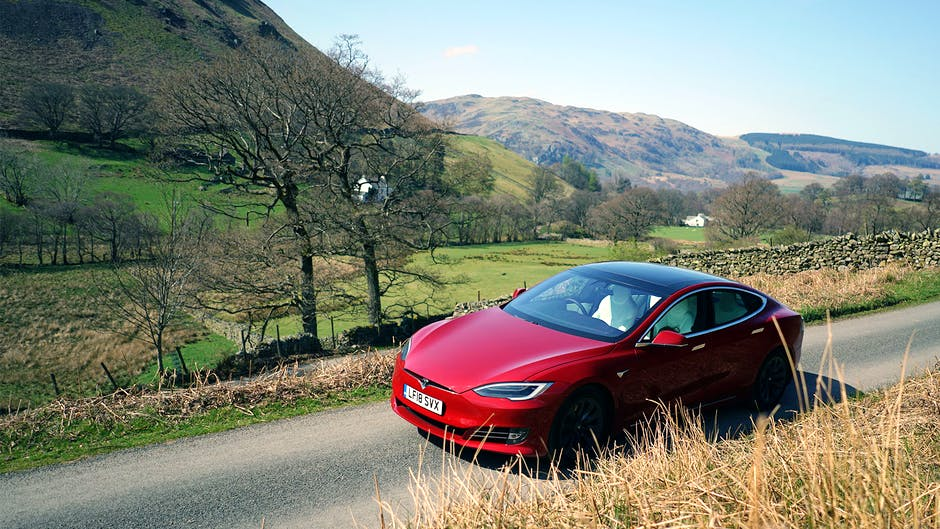 Tesla Model S 100D in red against a Lake District backdrop