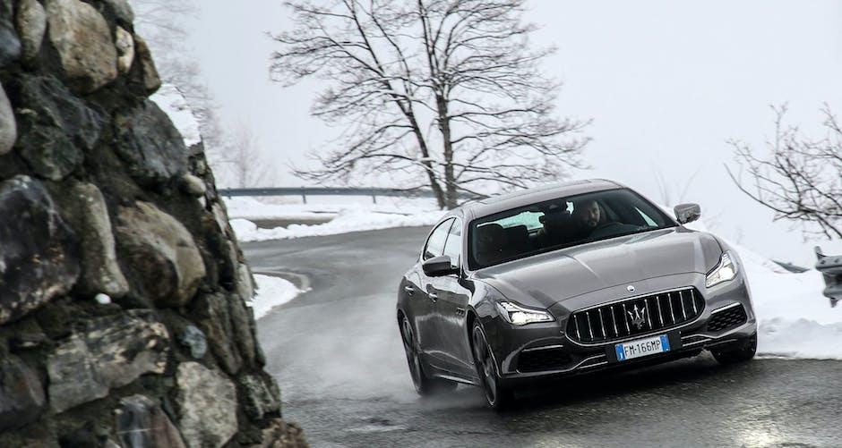 Maserati Quattroporte GTS 2018 cruising along an icy mountain road