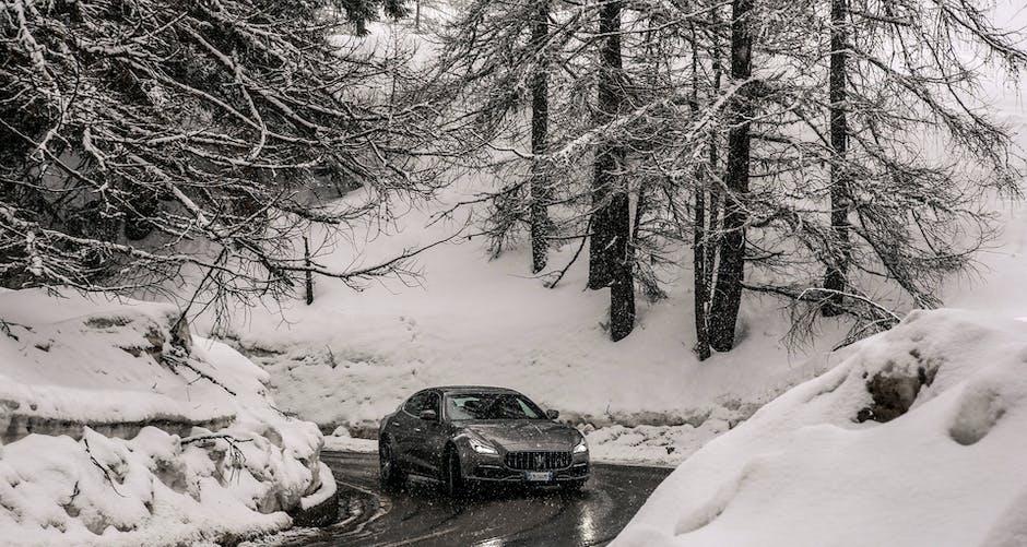 Maserati Quattroporte GTS 2018 in a snowy forest